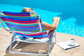 The woman relaxing near the pool — Stock Photo