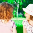Two girls at the park - Stock Photo