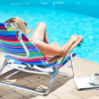 Stock Photo: The woman relaxing near the pool