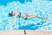 Woman in the pool — Stock Photo