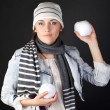 Stock Photo: Womwith snowballs