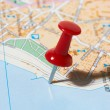Red pushpin on a map — Stock Photo