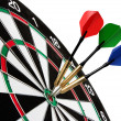 Stock Photo: Colorful darts hitting target