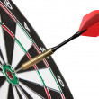 Stock Photo: Red dart hitting a target