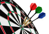 Colorful darts hitting a target — Stockfoto