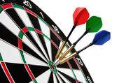Kleurrijke darten raken een doel — Stockfoto