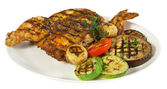 Grilled chicken on white plate — Стоковое фото