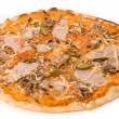 Pizza with sauce, cheese, ham, sausage, tomato, pork, mushrooms, - Zdjęcie stockowe