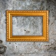 Gold frame on a old wall background — Stock Photo