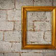 Gold frame on a old wall background — Stock Photo #6974889