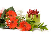 Magnificent bouquet gerbera and present box on a white — Stock Photo