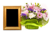 Beautiful bouquet and golden frame on a white — Stock Photo
