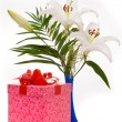 beautiful bouquet of white lilies and present box on a white bac — Stock Photo #7187301