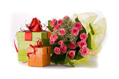 Beautiful Roses bouquet and present boxes on white background — Stock Photo