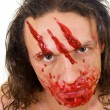 Stock Photo: Cannibal maniac with blood on face