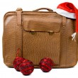 Old suitcase with a Christmas hat and balls isolated on a white — Stock Photo