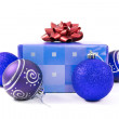 Christmas baubles and gift — Stock Photo