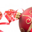 Red baubles over white — Stock Photo #7955094