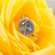 Golden ring with blue topaz — Stock Photo