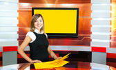 Pregnant television anchorwoman at TV studio — Stock Photo