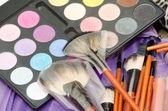 Makeup eye shadows and brushes — Stock Photo