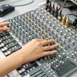 Female hands at audio control console — Stock Photo