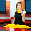 Stock Photo: Television anchorwoman has coffee break