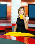 Television anchorwoman has coffee break — Stock Photo