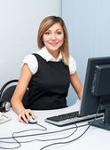 Young woman at computer — Stock Photo
