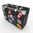 Black leather suitcase with travel stickers. — Stock Photo #6922761