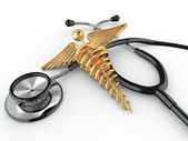Stethoscope with symbol of medicine, caduceus. — Stock Photo