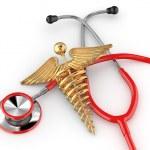 Stethoscope with symbol of medicine, caduceus. — Stock Photo