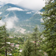 Fog in valley between high mountains — Stockfoto #6933552