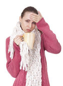 Sick woman with cup in winter sweater and scarf — Stock Photo