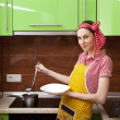 Beautiful happy womin kitchen interior cooking — Stok Fotoğraf #7020061