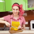 Woman in the kitchen with knife and lemon — Stock Photo