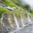 Stock Photo: Waterfall on mountain road