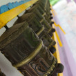 Prayer wheels in a row - Stok fotoğraf