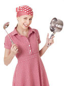 Playful housewife with ladle and pan — Stock Photo