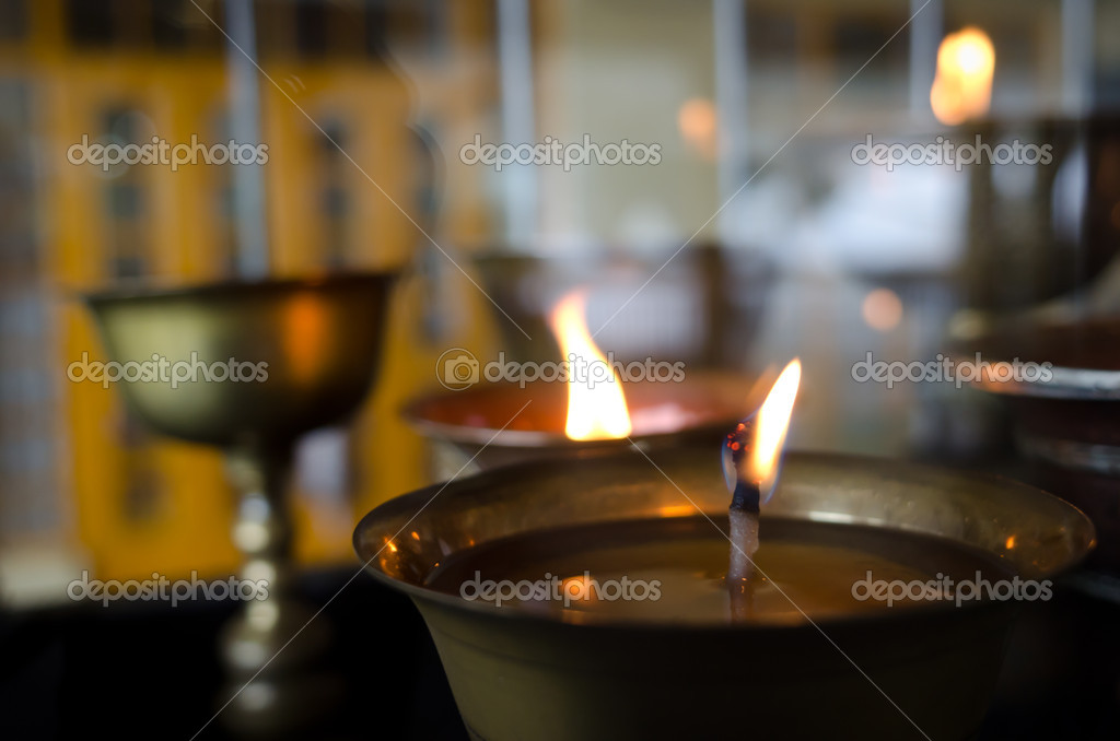 Flame on lamp light oil in Buddhist temple — Stock Photo #7164789