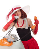 Fashion girl in retro style with vintage phones — Stock Photo