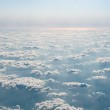 Beautiful view above cloudscape, mountains, river — Stock Photo