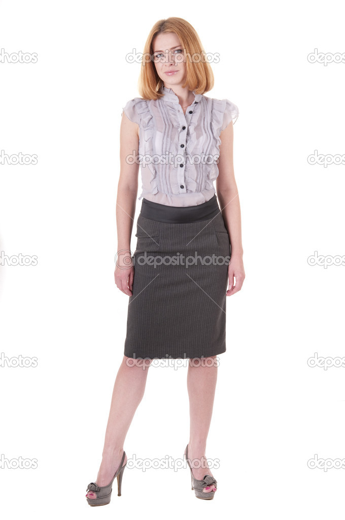 Full-lenght portrait beautiful lookind down young woman in blouse and skirt on white  Stock Photo #7823381