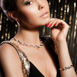 Elegant fashionable woman with golden jewelry — Stock Photo #7112686