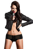 Elegant fashionable woman with a pistol in hands — Stock Photo