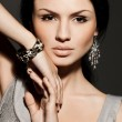 Foto Stock: Elegant fashionable woman with jewelry