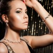 Stock Photo: Elegant fashionable woman with golden jewelry
