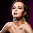 Elegant fashionable woman with violet jewelry — Stock Photo #7276177