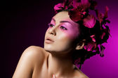 Elegant fashionable woman with orchid — Stock Photo