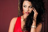 Elegant fashionable woman in red dress — Stockfoto